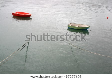A peaceful waterscape witn two floating boats