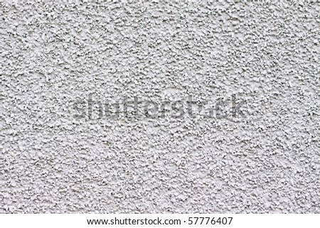 A pebbly, gritty white grey texture or background.