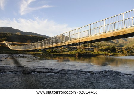 stock photo : A pedestrian bridge over flood prone river in KZN South Africa