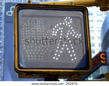 A Pedestrian crosswalk sign in New York City signals it's OK to cross