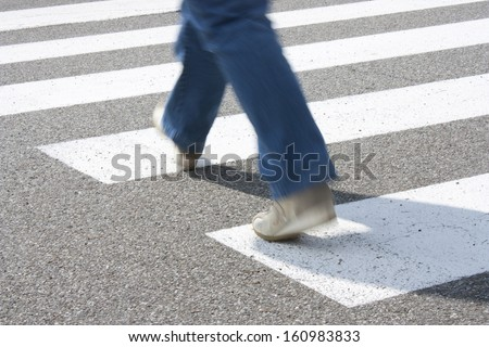 a pedestrian while crossing the road at the pedestrian crossing