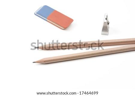 a pen, a sharpener and an eraser