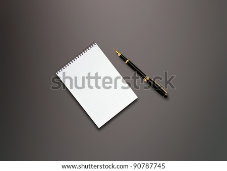 a pen and blank paper on the table