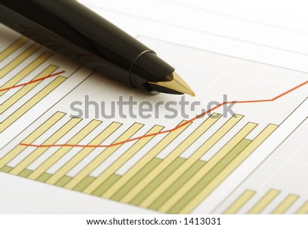 A pen on a positive earning chart.(shallow focus on the tip of the pen)