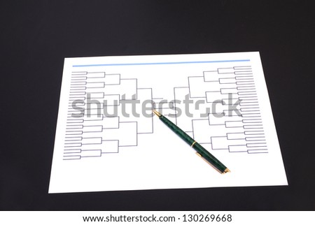 A pen on top of an blank March Madness tournament bracket