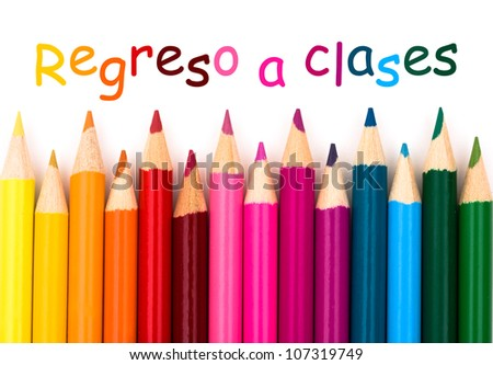 A pencil crayon border isolated on white background with words Regreso a Clases, Spanish back to school