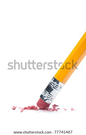 A pencil eraser removing a written mistake on a piece of paper.