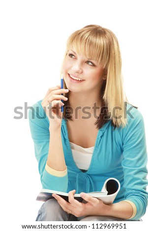 A pensive college girl with a pen and a textbook, isolated on white