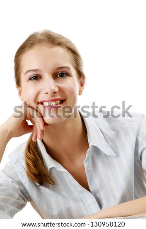 A pensive young woman at the desk, isolated on white background