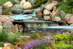 A perfect cascade of water over the rocks in a garden