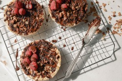 A perfect healthy snack - Rice cake top with almond chocolate spread, raspberry, granola and chocolate.