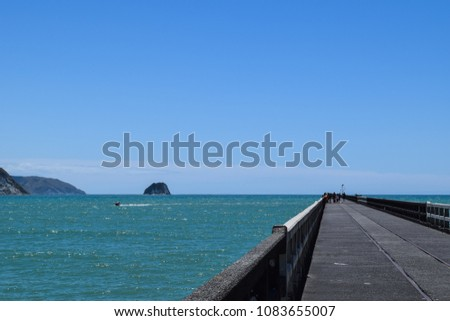 A perfect long shot along Tolaga Bay Wharf with the Pacific Ocean in the background at Tolaga Bay, New Zealand. #1083655007