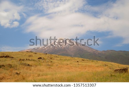 A perfect natural lighting view of Damavand mountain with extend foothill and snow on pic and clouads