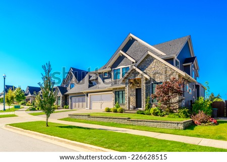 A perfect neighborhood. Houses in suburb at Spring in the north America. #226628515