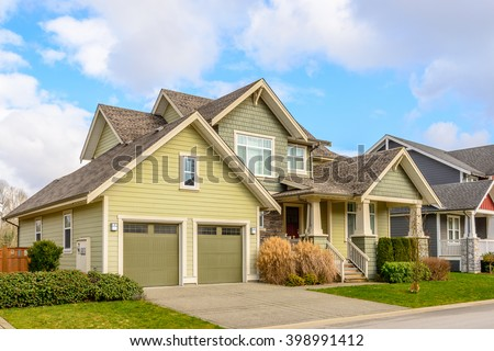A perfect neighborhood. Houses in suburb at Spring in the north America. #398991412