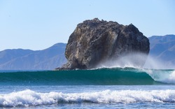A perfect wave at the famous surf spot Witch's Rock located in the Santa Risa national park in Guanacaste, Costa Rica.
