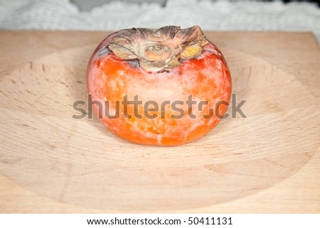A persimmon is the edible fruit of a number of species of trees of the genus Diospyros  in the ebony wood family