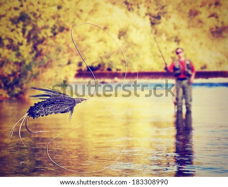 a person fly fishing with a big ...