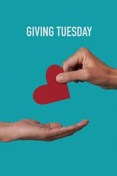 a person giving a red heart to another person and the text giving tuesday on a blue background