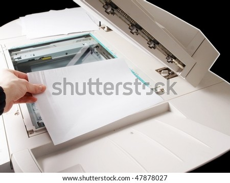 A person handling a multi purpose copier machine