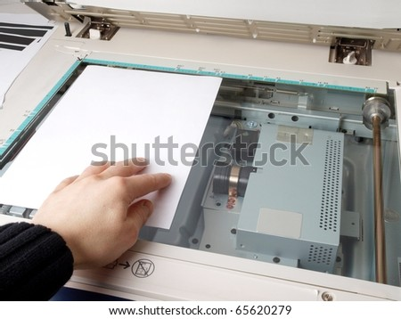 A person handling a multi purpose copier machine