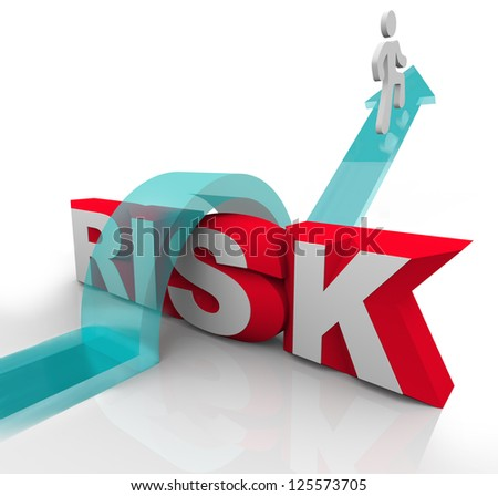 A person jumps over the word Risk to symbolzine avoiding danger or hazards and being careful and prepared to overcome dangerous obstacles