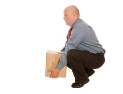 A person lifting a box using a good technique for manual handling.