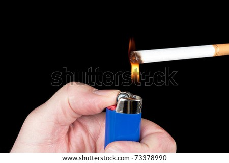 A person lights a cigarette with a blue butane lighter.