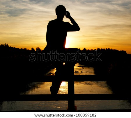 A person on a bridge making a photo