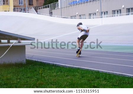 a person on rollers in a sports suit and a helmet rides a racing track, a theme of sport and recreation  #1153315951