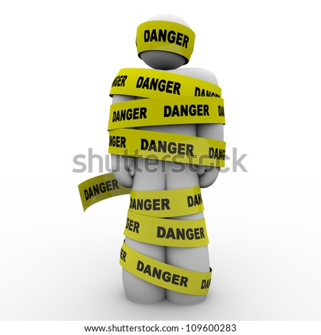 A person or man wrapped in yellow tape marked Danger, illustrating a warning, caution, hazard, crisis or emergency