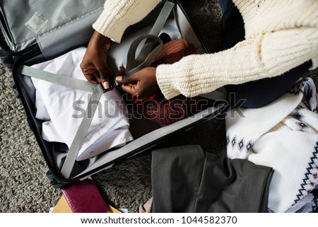 A person packing for a trip