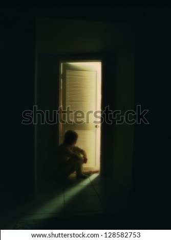 a person sitting outside a bedroom door