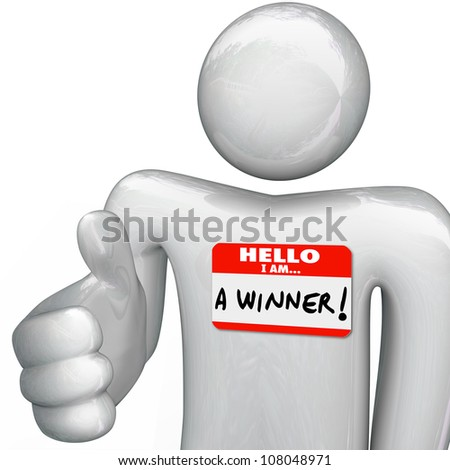A person wearing a nametag reading Hello I Am a Winner extends a hand for a handshake, as a successful man interviewing for a job or presenting a new opportunity