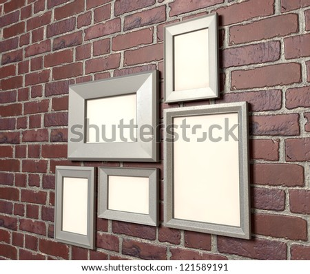 A perspective view of an arrangement of five blank metal picture frames hanging on a red clay brick  brick wall