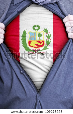 A Peruvian businessman rips open his shirt and shows how patriotic he is by revealing his countries flag beneath printed on a t-shirt