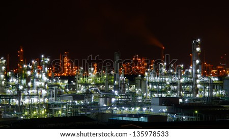 A petrochemical plant, with it\'s stainless steel cylinders, it\'s valves, chimneys, pipes