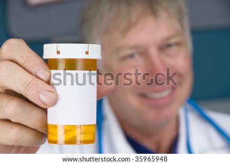 A pharmacist doctor holds up a pill bottle. Label is left blank for copy.