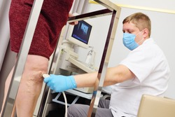 A phlebologist or vascular surgeon performs an ultrasound examination of the patient's veins. Prevention of varicose veins, thrombosis, rosacea. Prevention of varicose veins, thrombosis, rosacea.