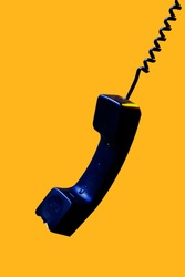 A phone receiver in motion, the edge of the telephone receiver is broken and hangs mid air. The interplay of the light and dark areas on the body of this object, says a lot about its life and death.