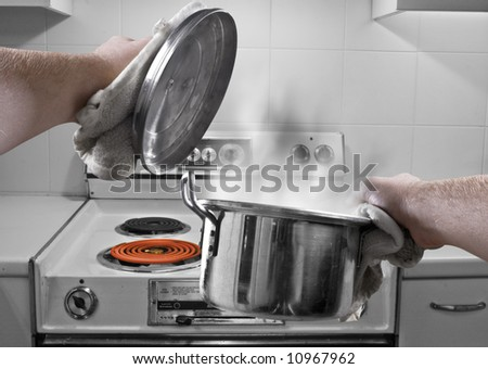 A photo-montage of holding a soup pan in the kitchen. - stock photo