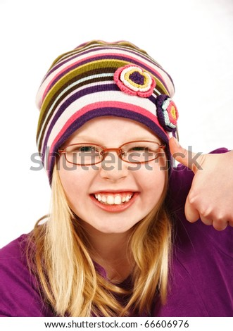 A photo of a Beautiful blond girl with hat making faces - stock photo