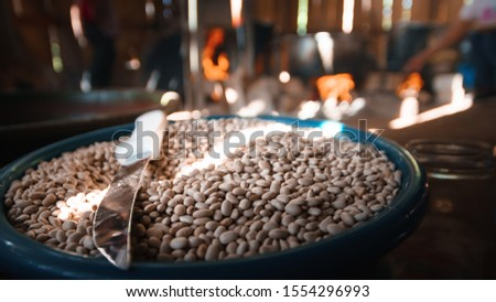 A photo of a boat full of beans with a knife, in a traditional Oaxaca kitchen, works to illustrate culinary folklore #1554296993