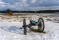 A photo of a Civil War cannon in the snow at the Gettysburg National Military Park battlefield in Pennsylvania where union and confederate soldiers battled in July of 1863.