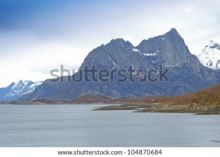 A photo of a fjord north of the polar circle in Norway