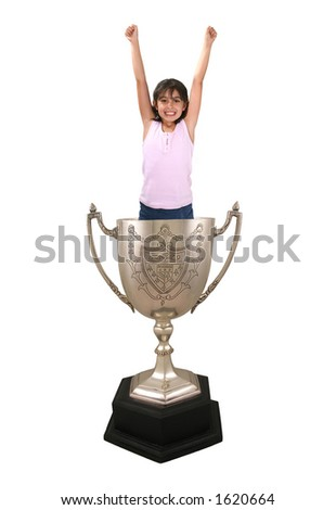 A photo of a girl celebrating inside a trophy cup