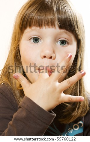 A photo of a girl, who just ate some cake - stock photo