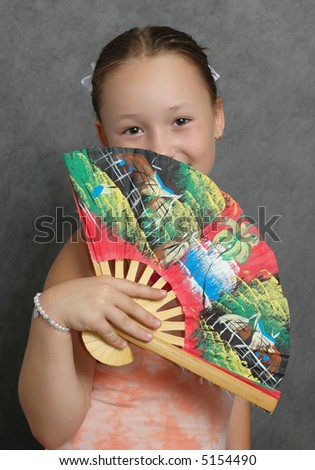a photo of a girl with an oriental fan