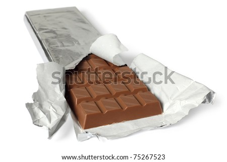 A photo of a large bar of milk chocolate. Shallow depth of field, focusing on the top of the first row. Clipping path included.