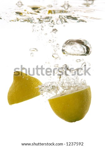A photo of a lemon dropped under water